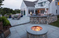 Outdoor kitchen at its best – in use during a cape cod summer evening